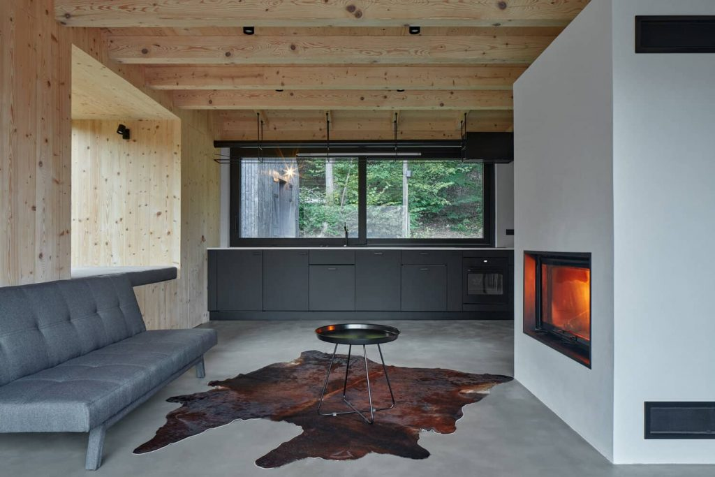 kitchen and fireplace 1024x683 A Cozy Cottage in the Woods by MjöLK Architects