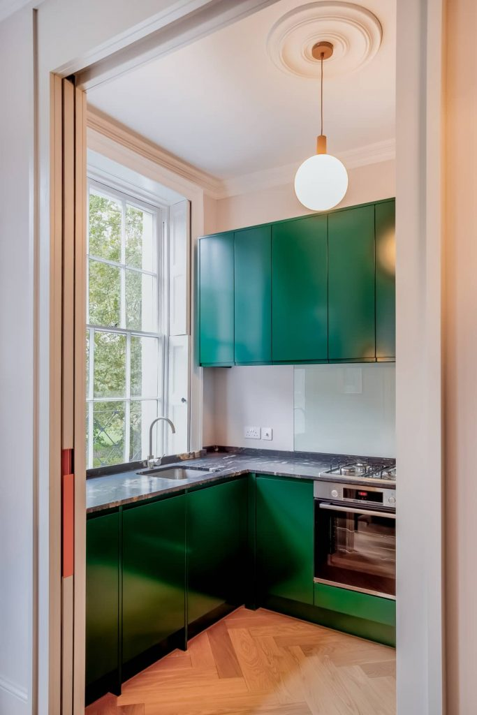 kitchen cabinets painted in green 683x1024 An 18th Century Apartment Renovation by Patalab Architecture