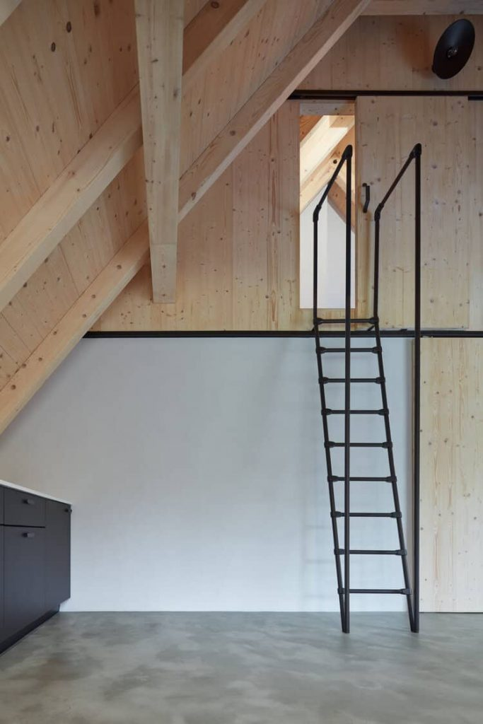 ladder to the bedroom 683x1024 A Cozy Cottage in the Woods by MjöLK Architects