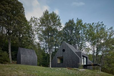 A Cozy Cottage in the Woods by MjöLK Architects