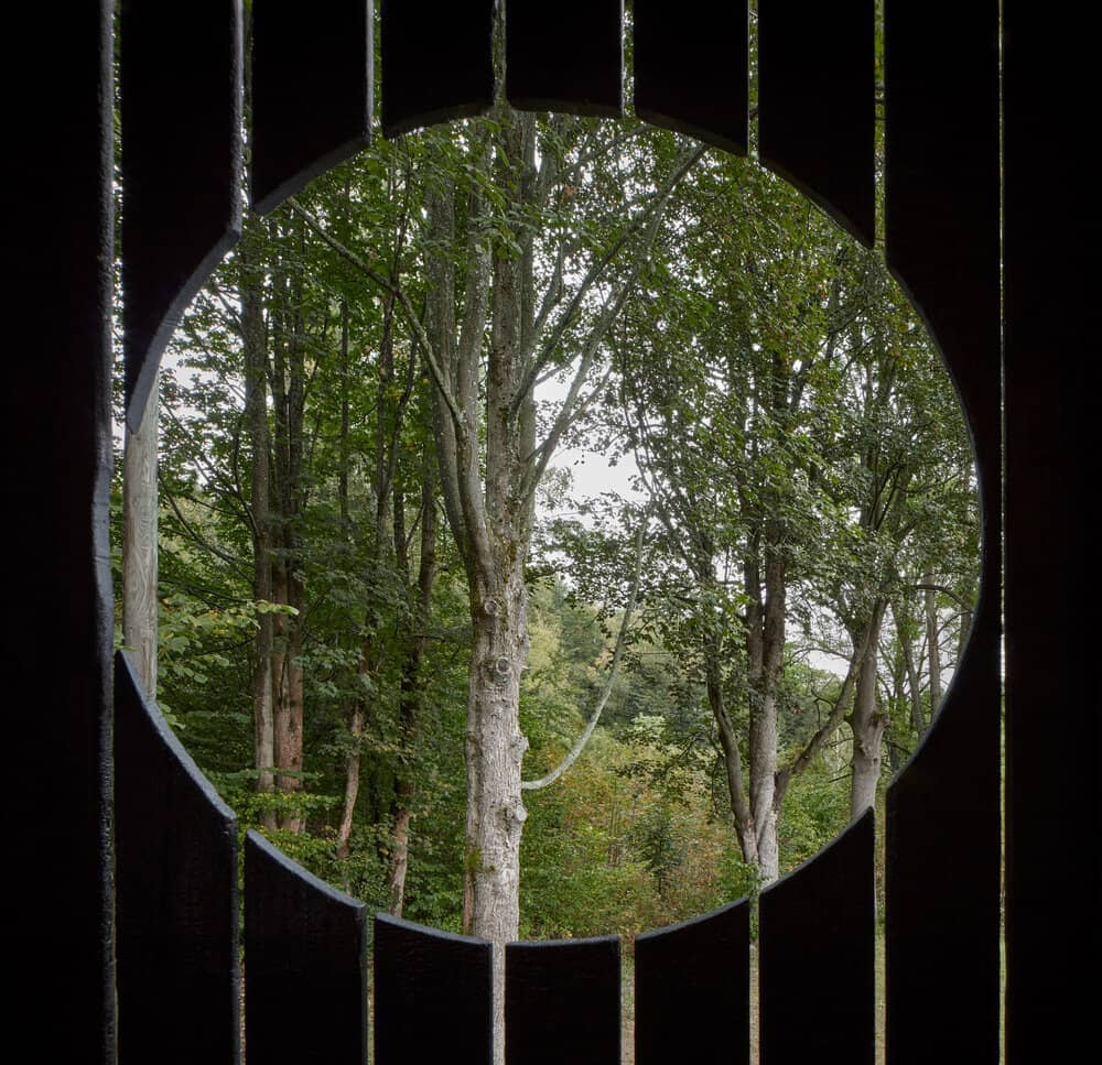 round window A Cozy Cottage in the Woods by MjöLK Architects