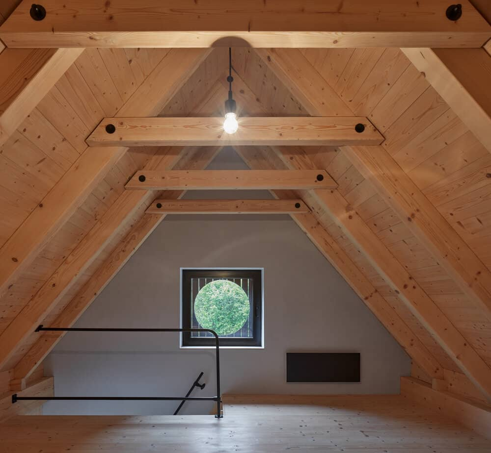 the view from the bed A Cozy Cottage in the Woods by MjöLK Architects