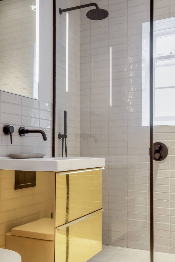 under sink unit claded in polished brass 683x1024 An 18th Century Apartment Renovation by Patalab Architecture