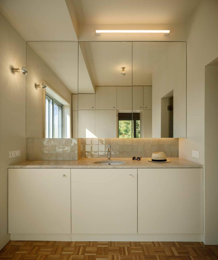 bathroom vanity 860x1024 Subtle Apartment Renovation by Costa Lima Arquitectos