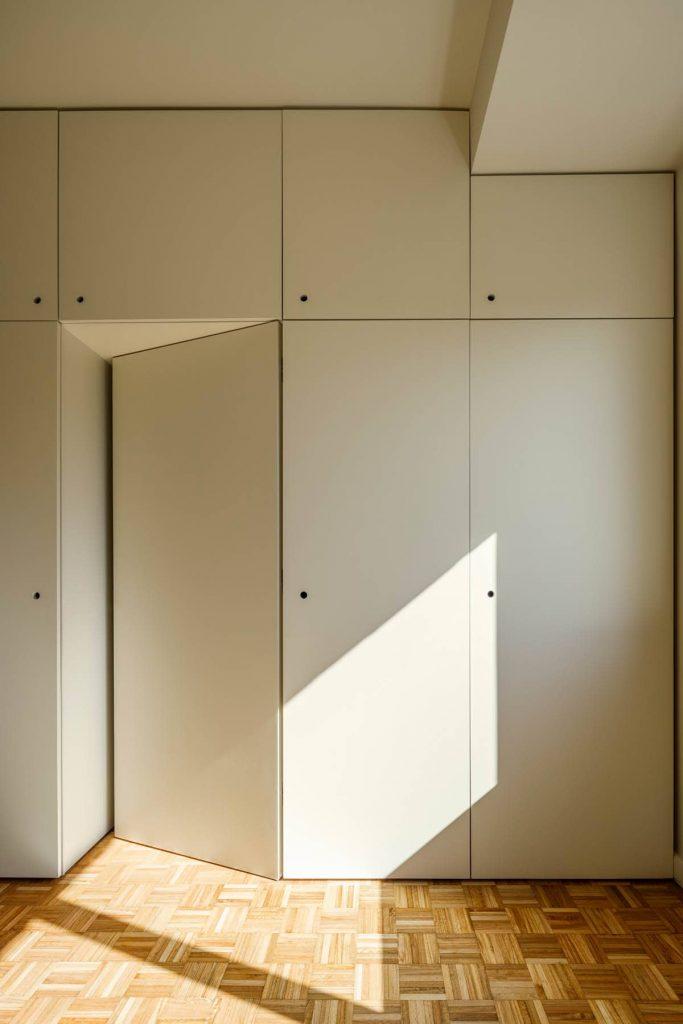 bedroom closet 683x1024 Subtle Apartment Renovation by Costa Lima Arquitectos