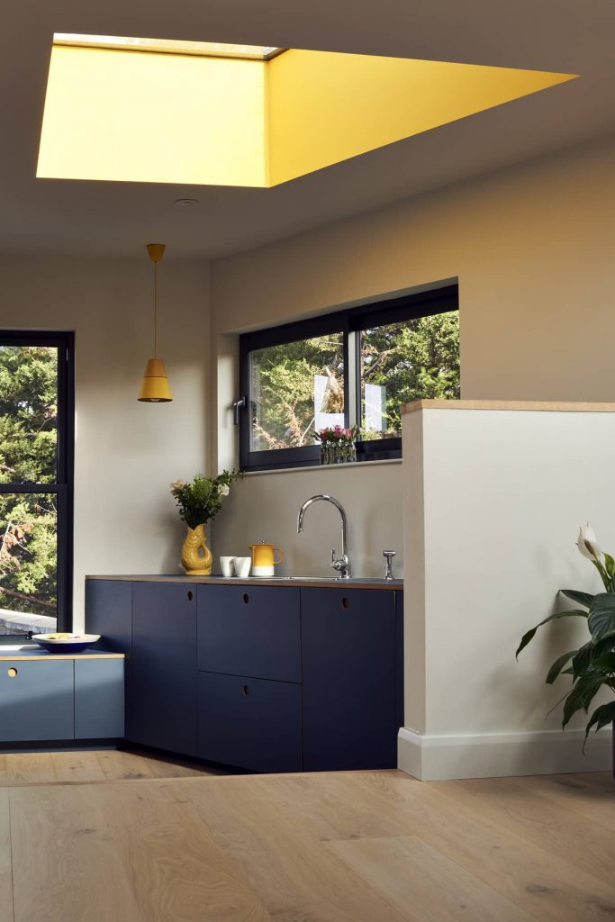 blue kitchen cabinets 683x1024 Loft Conversion and Roof Extension by Mitchell + Corti Architects