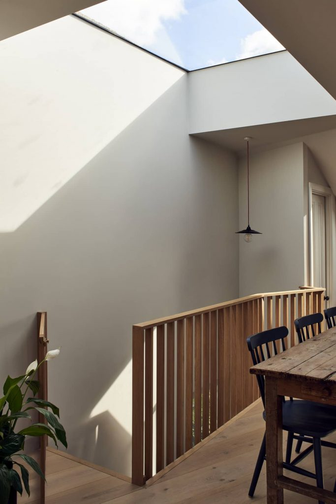 dining table and skylight 683x1024 Loft Conversion and Roof Extension by Mitchell + Corti Architects