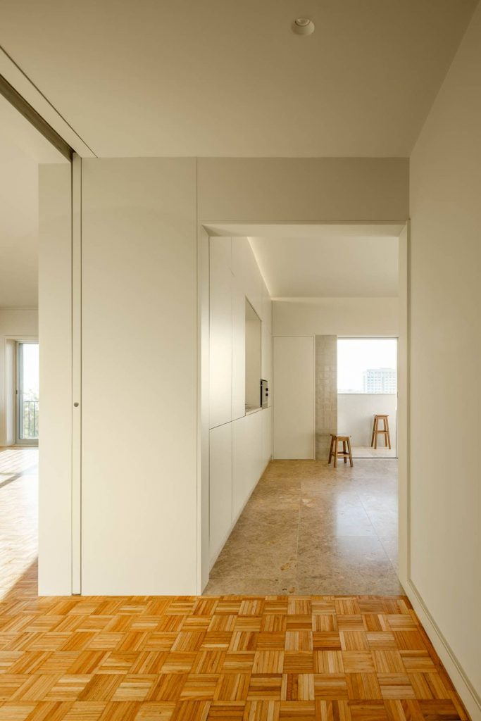 view to the kitchen 683x1024 Subtle Apartment Renovation by Costa Lima Arquitectos