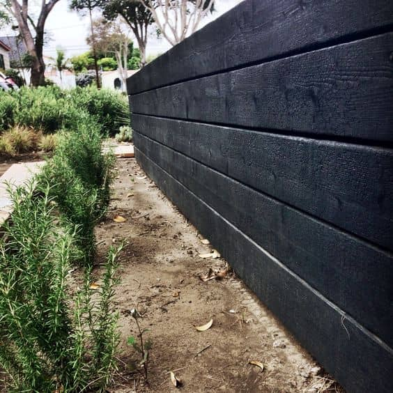 burnt wood wall 14 Patio Wall Ideas That Will Make Your Outdoor Space More Attractive