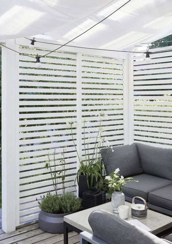 garden privacy screen 14 Patio Wall Ideas That Will Make Your Outdoor Space More Attractive