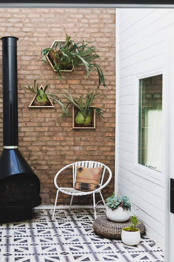 geometric staghorn fern boxes 14 Patio Wall Ideas That Will Make Your Outdoor Space More Attractive
