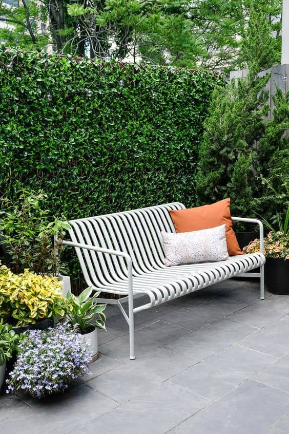 green patio hedge 14 Patio Wall Ideas That Will Make Your Outdoor Space More Attractive