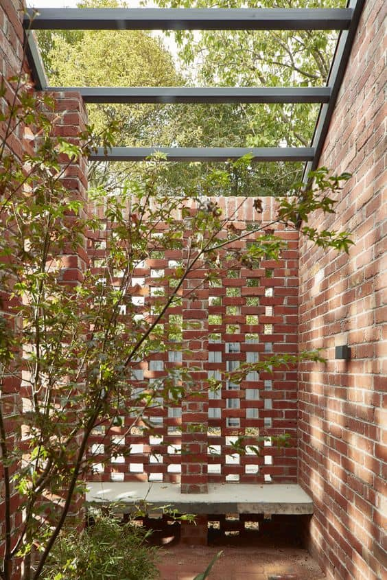 perforated brick patio wall 14 Patio Wall Ideas That Will Make Your Outdoor Space More Attractive