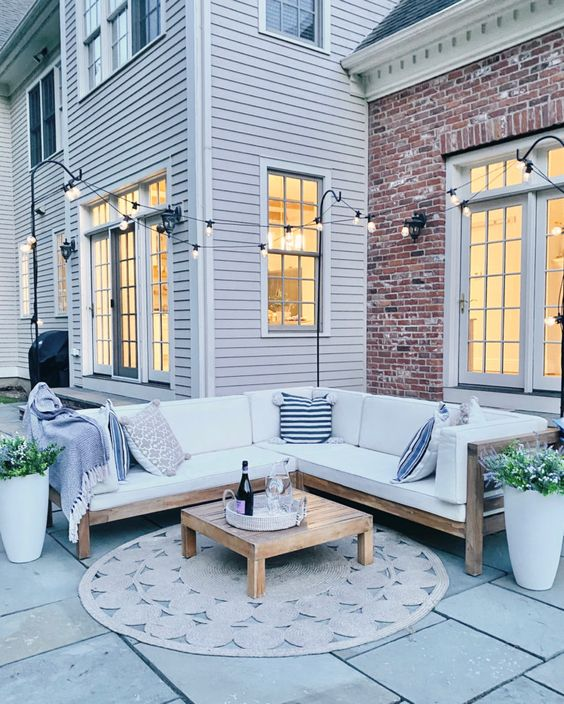 simple patio lighting solution 14 Patio Wall Ideas That Will Make Your Outdoor Space More Attractive