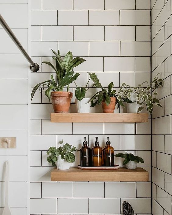 small bathroom remodel idea wall shelves with plants 16 Small Bathroom Remodel Ideas That Will Help You to Save Space