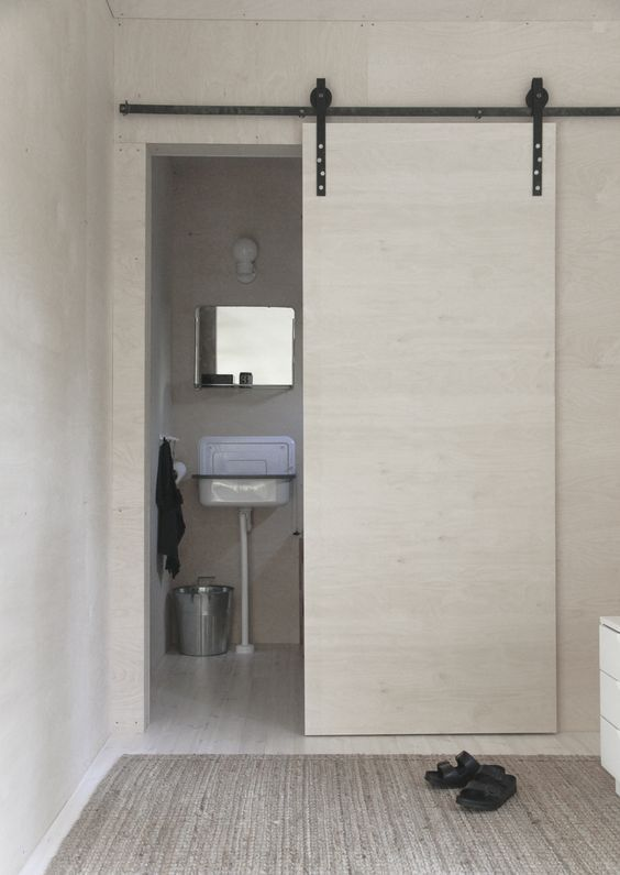 small bathroom remodel ideas sliding plywood doors 8 Small Home Design Ideas That Will Make Your Space Look Bigger