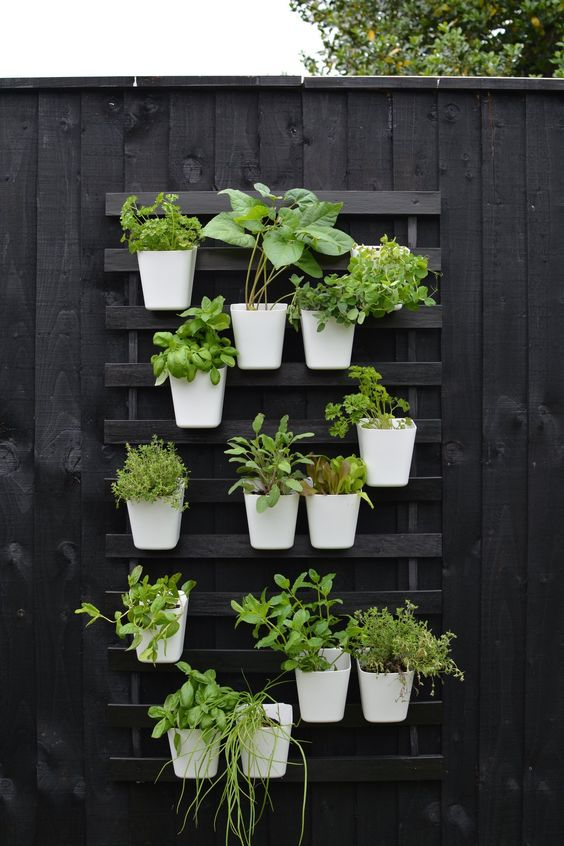 vertical gardening beds 14 Patio Wall Ideas That Will Make Your Outdoor Space More Attractive