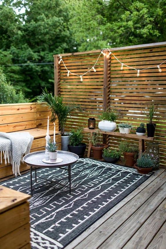 wooden slat wall 14 Patio Wall Ideas That Will Make Your Outdoor Space More Attractive