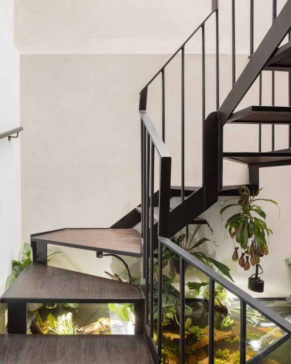 a curling steel stair Unagru Architects Transformed a Traditional Terrace Into a Bright Home