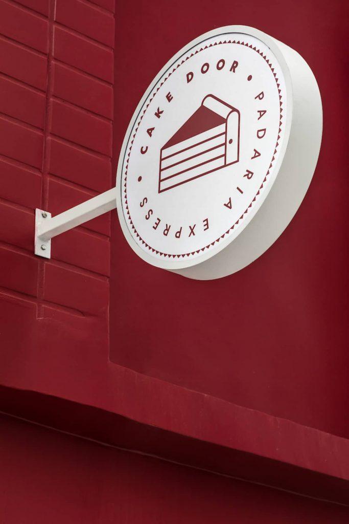 bakery signboard 683x1024 Cake Door   a Corner Bakery by BOSCARDIN CORSI Architects