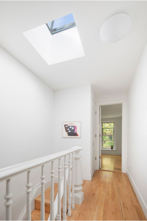 bedroom hallway 100 Year Old Townhouse Renovation by Studio Officina Architecture