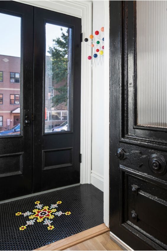 entry foyer 100 Year Old Townhouse Renovation by Studio Officina Architecture
