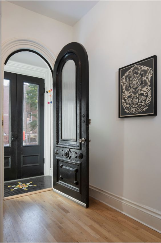 entry hallway 100 Year Old Townhouse Renovation by Studio Officina Architecture