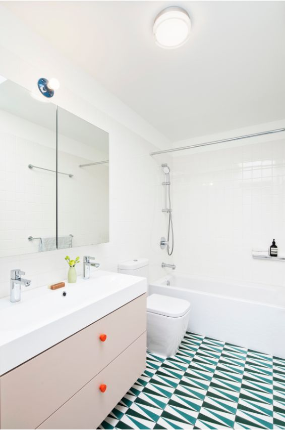 kids bathroom 100 Year Old Townhouse Renovation by Studio Officina Architecture