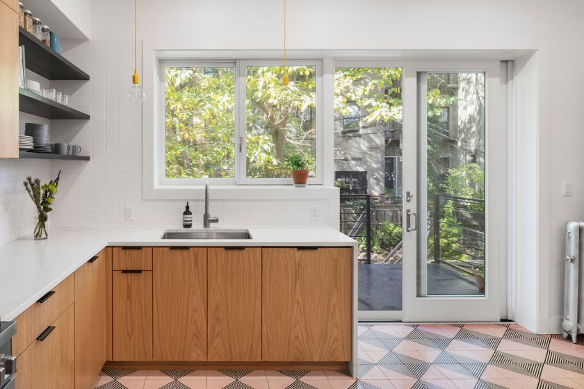 looking out to new deck 100 Year Old Townhouse Renovation by Studio Officina Architecture