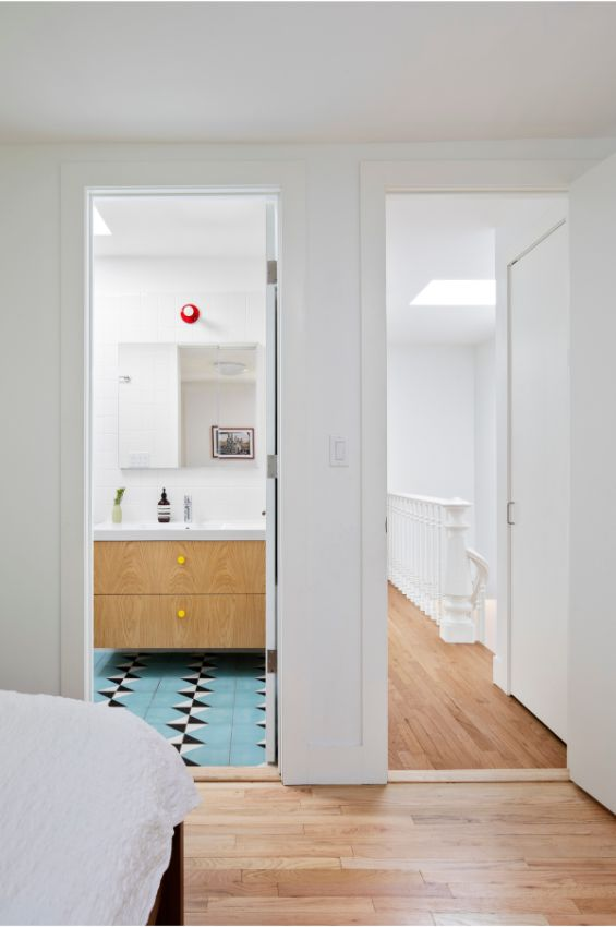primary bedroom and bathroom 100 Year Old Townhouse Renovation by Studio Officina Architecture