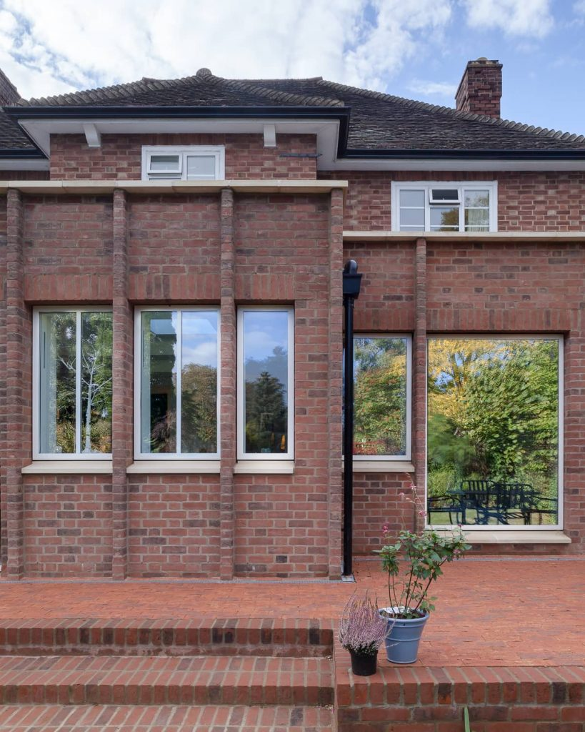 red brick facade and white windows 819x1024 A Renovation of a Detached House in a Cambridge Conservation Area