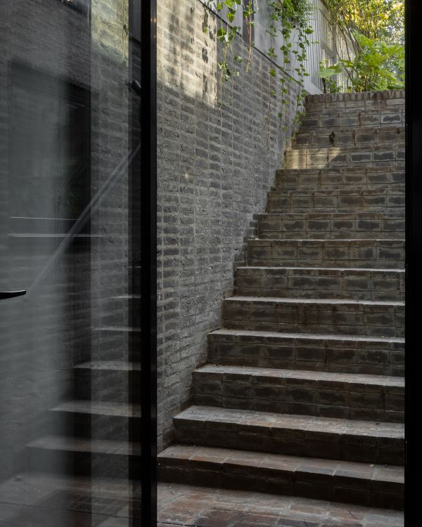 stair to the garden Unagru Architects Transformed a Traditional Terrace Into a Bright Home