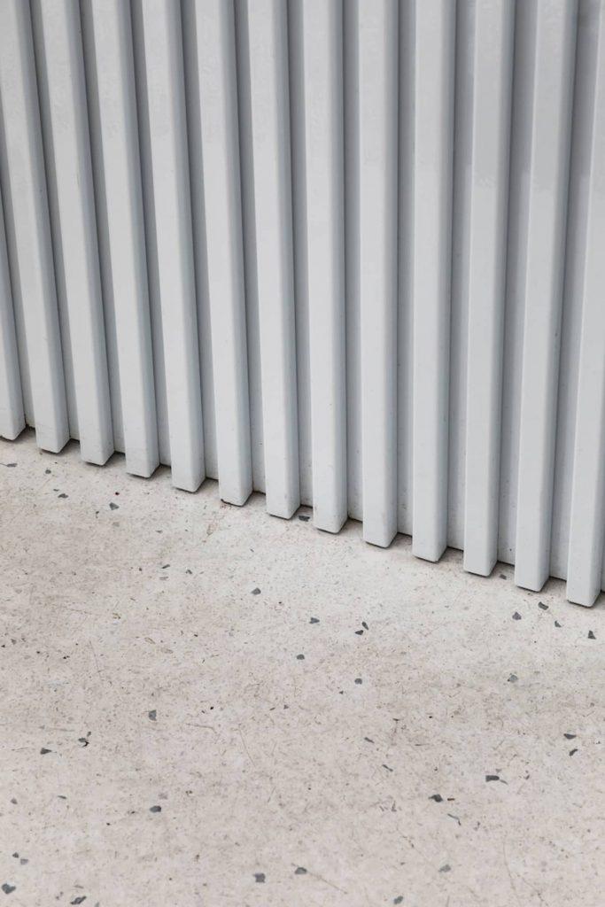 white metal slat detail 683x1024 Cake Door   a Corner Bakery by BOSCARDIN CORSI Architects