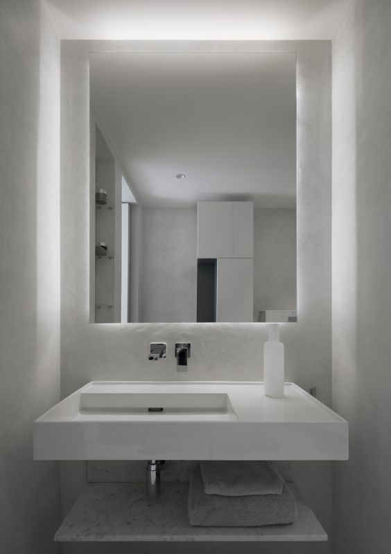 en suite bathroom Name Architecture Refurbished Two Parisian Apartments to Create a Unique Family Dwelling
