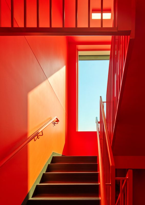 light and color wick students up the stairs UBCO Skeena Residence by PUBLIC Architecture Studio