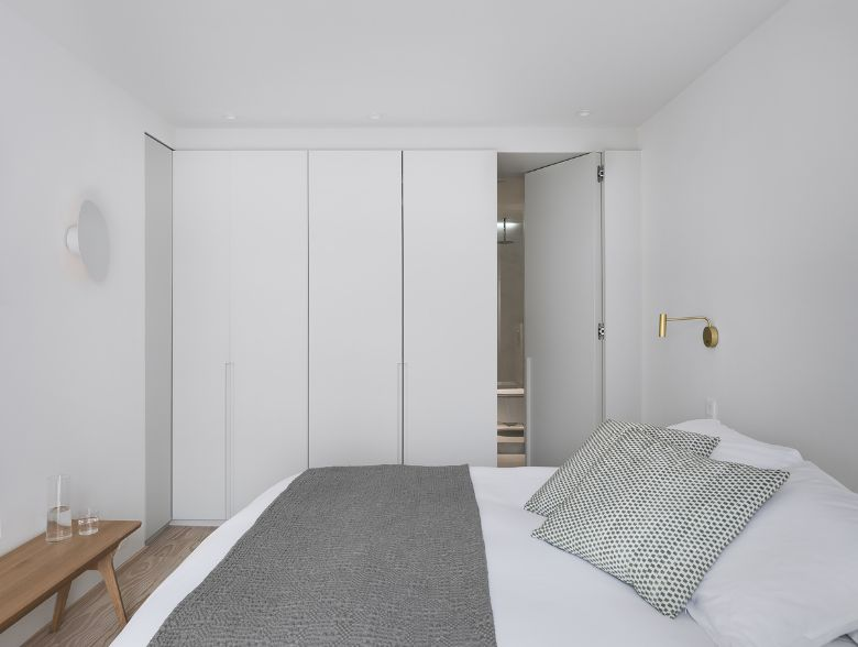 master bedroom Name Architecture Refurbished Two Parisian Apartments to Create a Unique Family Dwelling