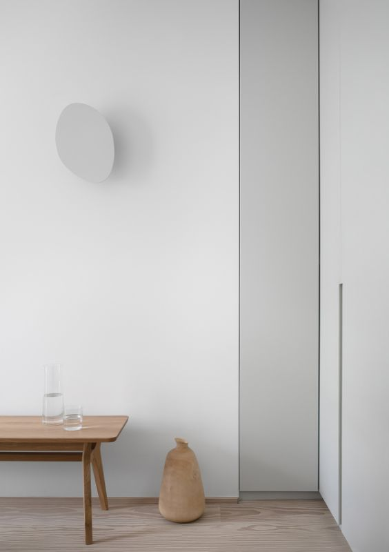 neutral tones Name Architecture Refurbished Two Parisian Apartments to Create a Unique Family Dwelling