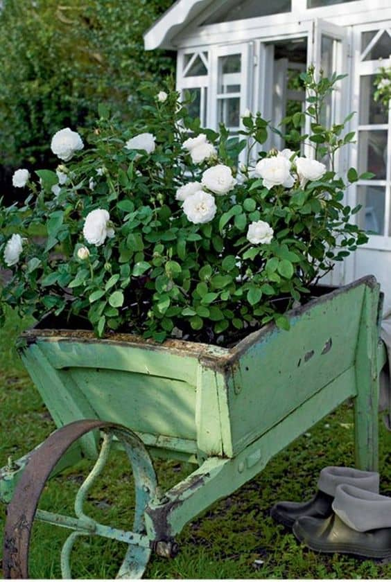 planted wheelbarrow 8 Landscape Ideas for Small Front Yards
