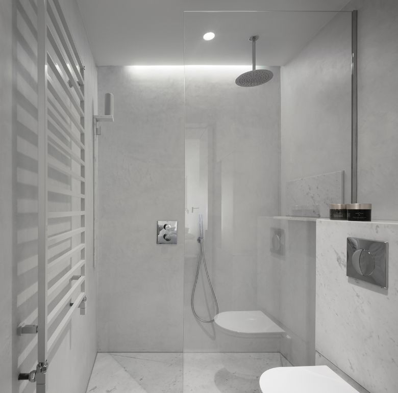 the en suite bathroom Name Architecture Refurbished Two Parisian Apartments to Create a Unique Family Dwelling