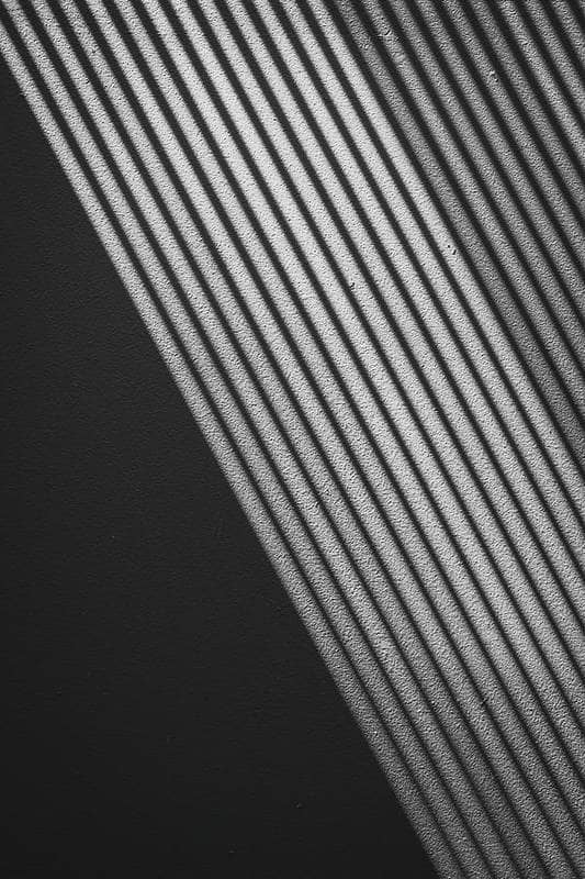 abstract black and white lines 10 Bedroom Wall Art Pieces That Will Brighten Your Mornings