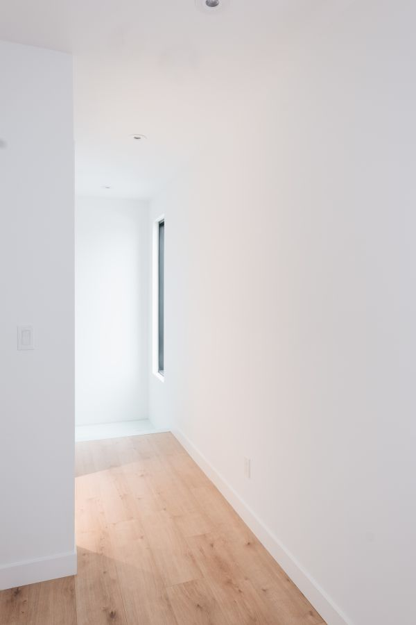 access to bedroom 95 Mackay Laneway House by Gabriel Fain Architects