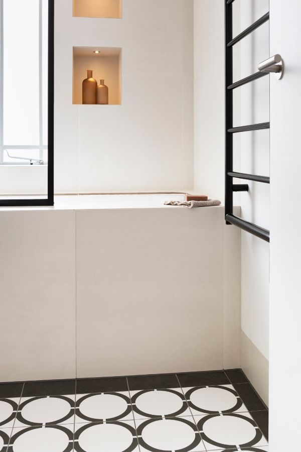 bathroom with lights on An 80sqm Apartment Renovation by Brosh Architects