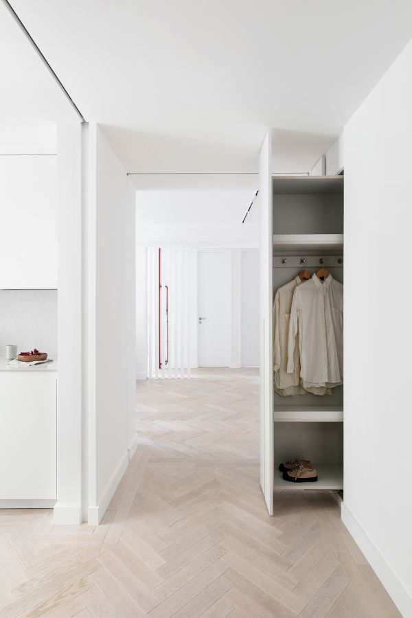 open storage unit created within wall niche An 80sqm Apartment Renovation by Brosh Architects