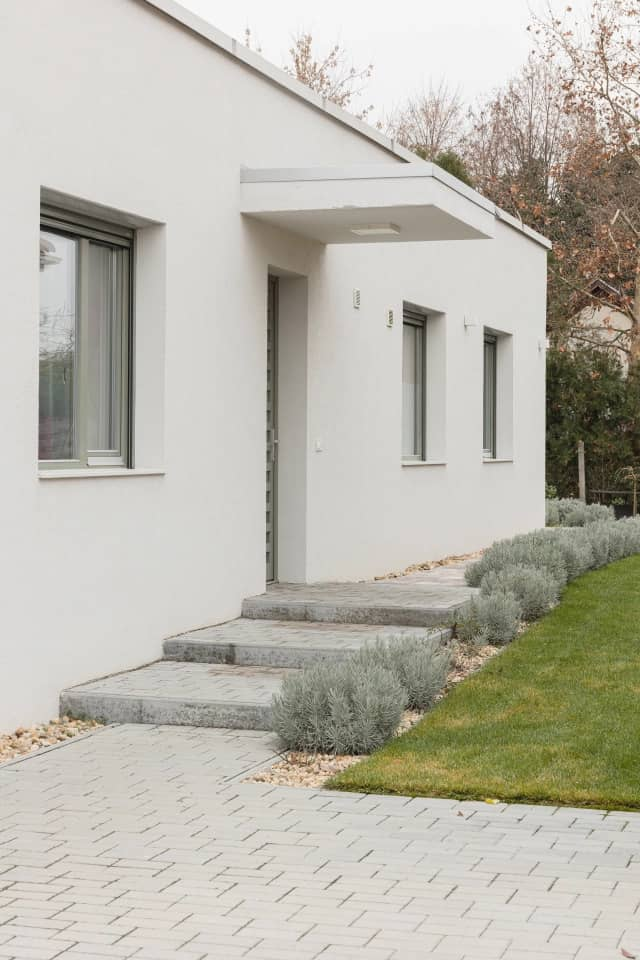 the white plastered facade Semi Detached House by Adam Balog