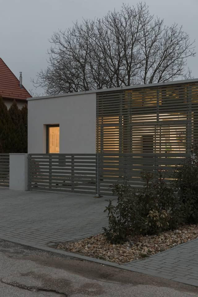 wooden slat facade Semi Detached House by Adam Balog