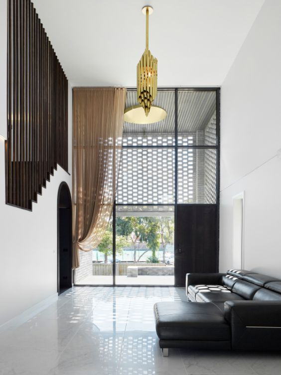 double height living room The Cuboid House by LLDS Architects
