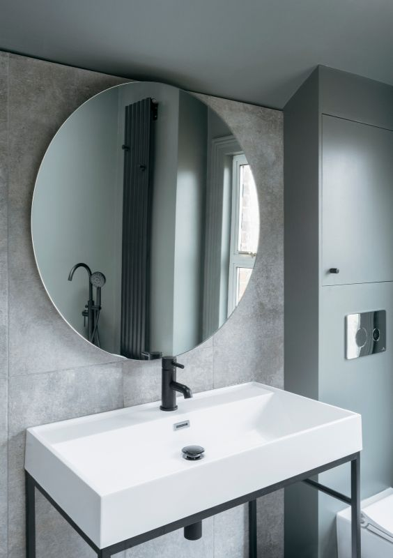 bathroom mirror A Material Driven Overhaul to a Victorian End Of Terrace by NOTO