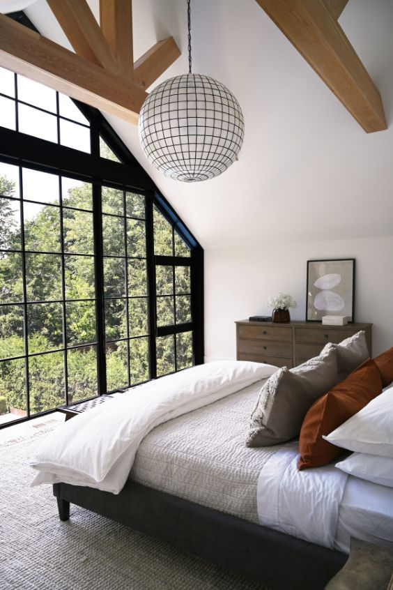 bedroom with soaring ceilings A Tired Bungalow Transformed Into a 2 Storey Family Dwelling by Ancerl Studio