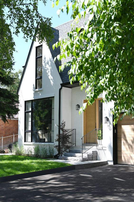 exterior facade A Tired Bungalow Transformed Into a 2 Storey Family Dwelling by Ancerl Studio