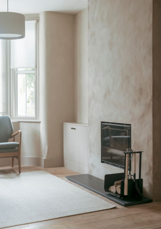 living room with a fireplace A Material Driven Overhaul to a Victorian End Of Terrace by NOTO